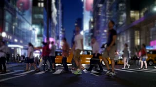 tourists walking in new york city at night