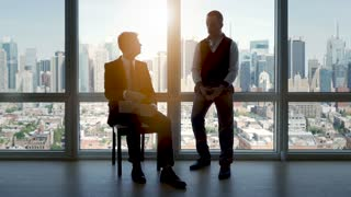 two business professionals having a meeting in modern office talking together