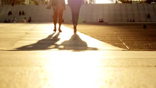 two females walking together. women lifestyle. fashion. silhouette. feet foot