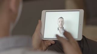 two young casual man having a video chat conversation using mobil tablet pc