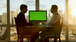 two young entrepreneurs talking about business. charts diagrams. green screen