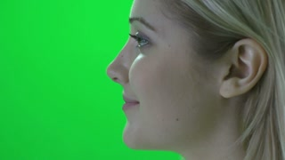 face close up of happy smiling women isolated on greenscreen