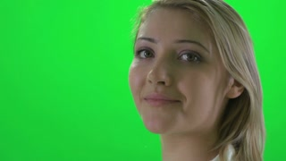 face close up of young blond women isolated on greenscreen