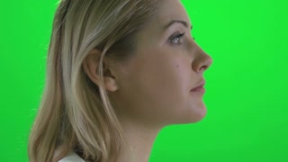 face profile view of attractive young blond women isolated on greenscreen