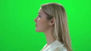 side profile face view of young blond women isolated on greenscreen