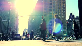 walking people crossing street in new york city. sun flare urban lifestyle