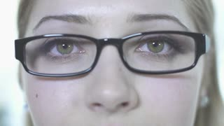 women eyes close up eyeglasses