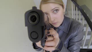 women officer agent shooting gun weapon