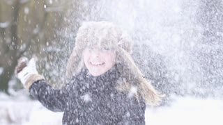 women playing in snow winter time slow motion