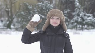 women throwing snow ball slow motion
