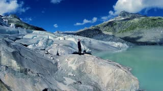 young carefree man enjoying mountain glacier nature landscape