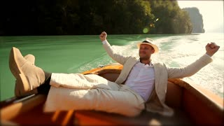 young casual man enjoying life on boat ride doing winning pose