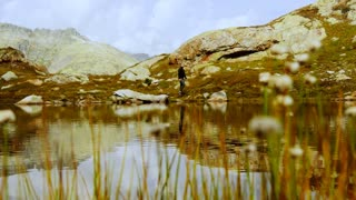young caucasian male hiker hiking alone in mountain landscape scenery