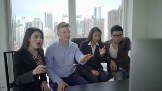 young diverse multi ethnic group of business people sharing exciting news