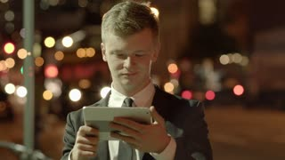 young entrepreneur having a video chat conversation using a tablet pc outdoors