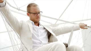 young handsome caucasian man wearing casual white suit working outdoors
