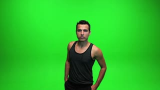young male model posing. isolated green screen