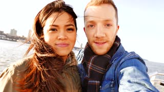 young mixed couple outdoors at sunshine. happiness lifestyle background