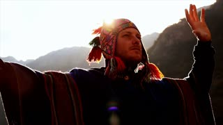 young shaman man doing mediation recreation activity outdoors at sunset sky