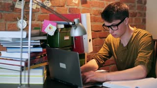 Angry student finish working on laptop at home