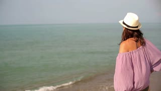 Attractive woman looking at the sea