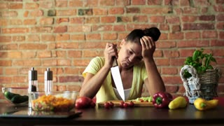 Bored woman preparing vegetable salad