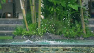 Boy coming put from water in the pool, slow motion shot at 240fps