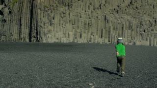 Boy falling down on Reynisfjara beach at south coast of Iceland, slow motion sho