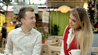Boy gives present to his girlfriend on the date and feels happy