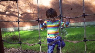 Boy playing on the rope, steadycam shot, slow motion shot at 240fps