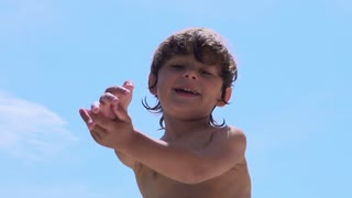 Boy waving hands and smiling to the camera, slow motion shot at 240fps