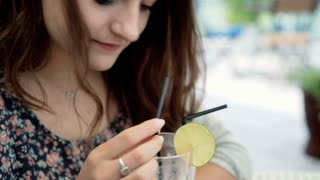 Brunette girl drinking cocktail and looking very happy