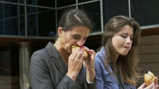 Business colleagues eating sandwich, slow motion shot at 240fps, steadycam shot