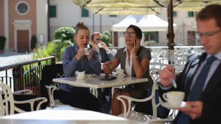 Business people during lunch time in the restaurant, outdoor