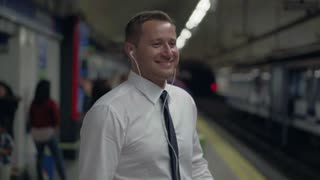 Business person dancing on metro station, slow motion shot at 240fps, steadycam