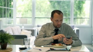 Businessman drinking water and using modern technology