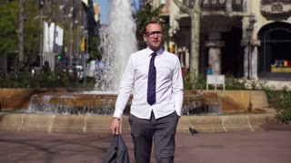 businessman holding his jacket and approaching to the camera, slow motion 240fps