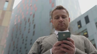 Businessman using cellphone in the city