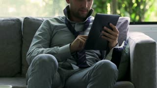 Businessman using tablet and smiling to the camera, steadycam shot