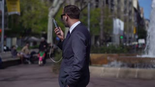 businessman  walking and talking on his cellphone, slow motion