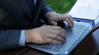 businessman's hands typing on the laptop