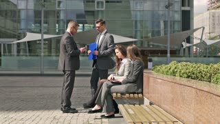 Businesspeople chatting while having a break