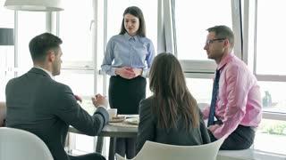 Businesspeople listening speech of their boss