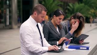 Businesspeople receiving bad news and worried about them