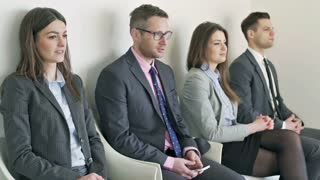 Businesspeople waiting for interview and boss coming