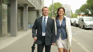 Businesspeople walking and talking in the city, steadycam shot