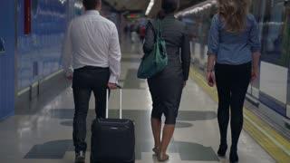 Businesspeople walking on platform, slow motion shot at 240fps, steadycam shot