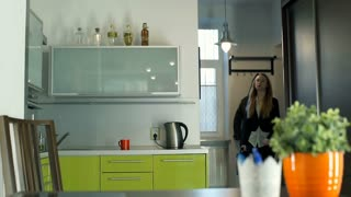 Businesswoman coming home and make herself a coffee, steadycam shot