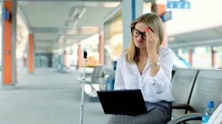 Businesswoman finish working on laptop because of painful headache