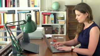 Businesswoman start working on laptop, steadycam shot